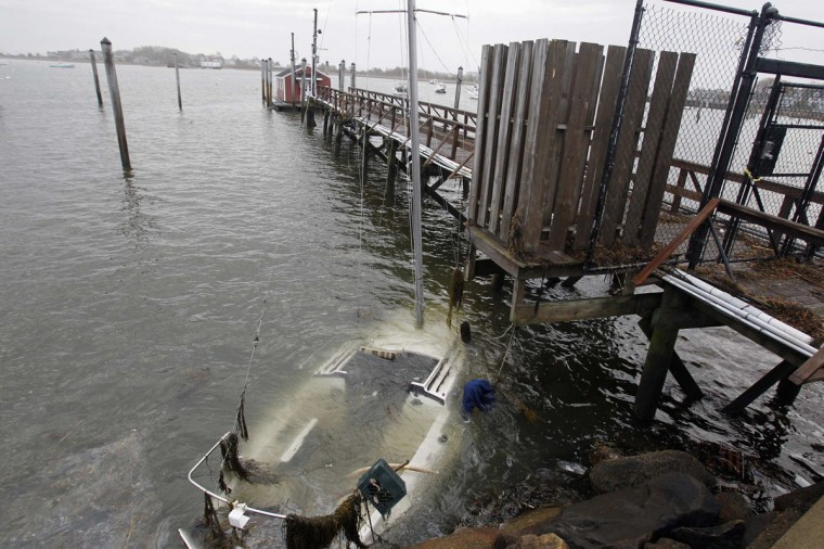 October 30, 2012: A boat which sunk after becoming unmoored by strong winds caused by Hurricane Sandy is submerged in Scituate Harbor in Scituate, Massachusetts. (Jessica Rinaldi/Reuters)