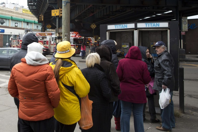 People queue to use a payphone in the Brighton Beach neighborhood of New York from Hurricane Sandy in New York October 31, 2012. Cell phone coverage was widely affected by the storms that hit the region with Hurricane Sandy. (Andrew Kelly /Reuters)
