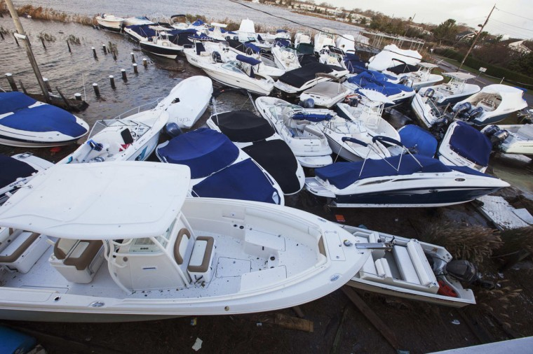 October 30, 2012: Boats piled up by storm surge and the high tide lie in a pile at a marina in East Quogue, New York. (Lucas Jackson/Reuters)