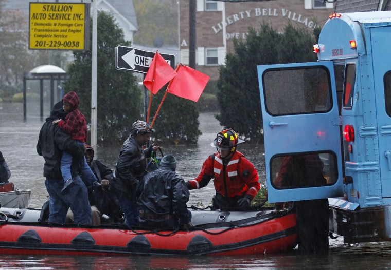 October 30, 2012: Residents are rescued by emergency personnel from flood waters brought on by Hurricane Sandy in Little Ferry, New Jersey. (Adam Hunger/Reuters)
