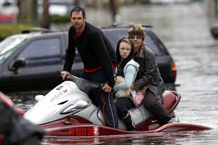 October 30, 2012: A resident assists in rescue efforts with his jet ski as emergency personnel rescue residents from flood waters brought on by Hurricane Sandy in Little Ferry, New Jersey. (Adam Hunger/Reuters)