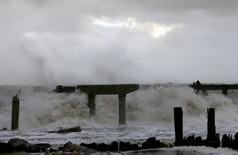 October 30, 2012: Waves crash against the demolished section of a boardwalk at the end of Pacific Avenue in the north end of the city, in the aftermath of Hurricane Sandy's landfall in Atlantic City, New Jersey. (Tom Mihalek/Reuters)