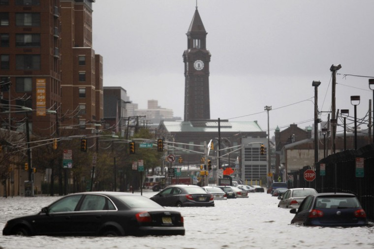 October 30, 2012: Cars are seen on a street flooded at Hoboken in New Jersey. (Eduardo Munoz/Reuters)