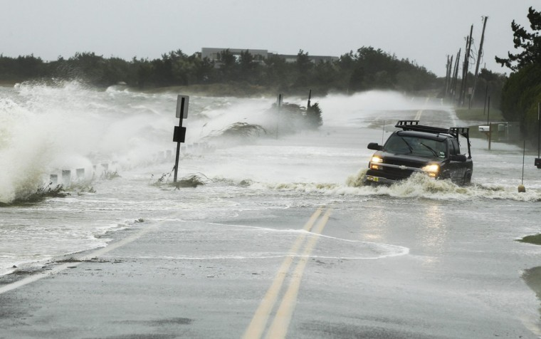 October 29, 2012: A truck drives through water pushed over a road by Hurricane Sandy in Southampton, New York. (Lucas Jackson/Reuters)