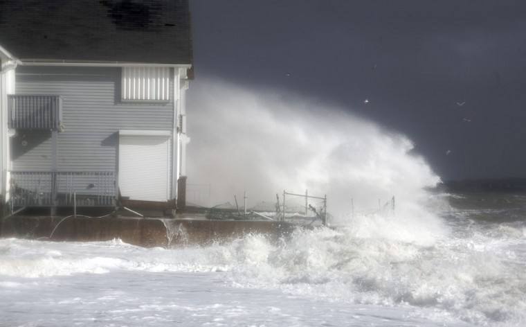 October 30, 2012: Waves crash against the shoreline during high tide in Milford, Connecticut. (Michelle McLoughlin/Reuters)