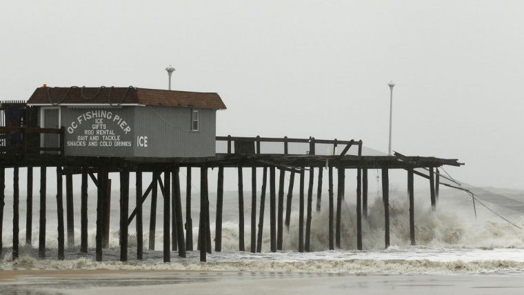October 29, 2012: Waves batter the remains of the fishing pier in Ocean City, Maryland, as Hurricane Sandy intensifies. (Kevin Lamarque/Reuters)