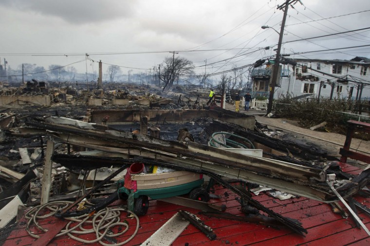 October 30, 2012: Homes that are devastated by fire and the effects of Hurricane Sandy are seen at the Breezy Point section of the Queens borough of New York. (Shannon Stapleton/Reuters)