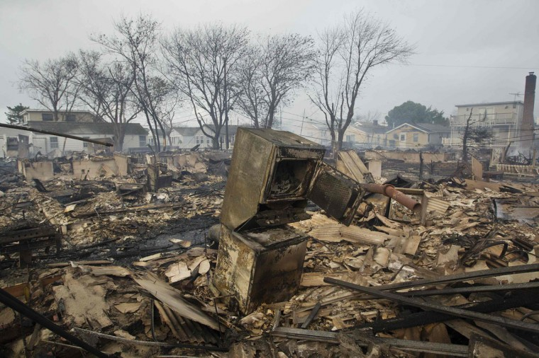 October 30, 2012: Homes devastated by fire and the effects of Hurricane Sandy at the Breezy Point section of the Queens borough of New York. (Shannon Stapleton/Reuters)