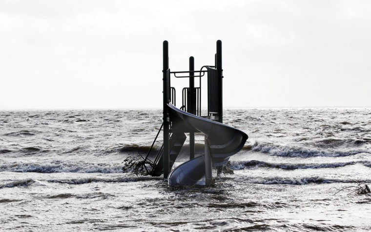 October 30, 2012: A playground apparatus stands surrounded by water pushed up by Hurricane Sandy in Bellport, New York. (Lucas Jackson/Reuters)