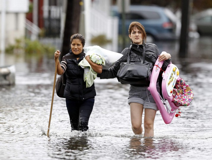 October 30, 2012: Residents make their way through flood waters brought on by Hurricane Sandy in Little Ferry, New Jersey. (Adam Hunger/Reuters)