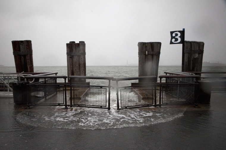October 29, 2012: Rising waters break the banks at Battery Park as Hurricane Sandy makes its approach in New York. (Andrew Kelly/Reuters)