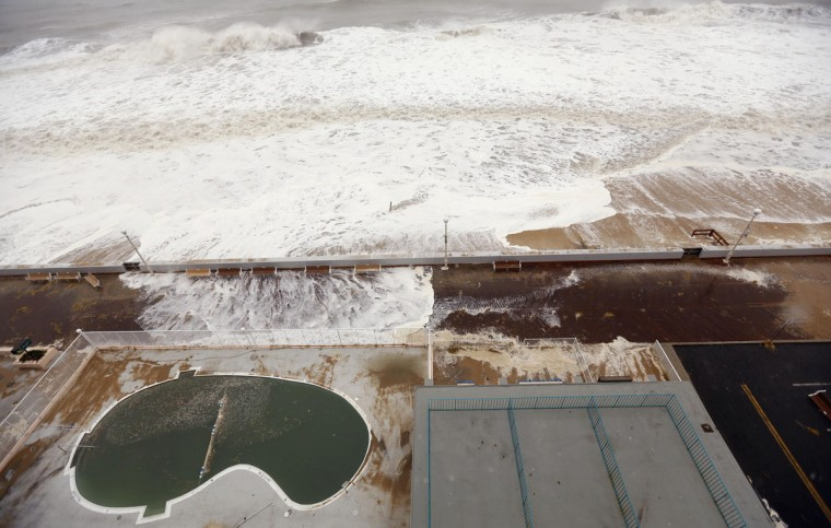 October 29, 2012: Incoming waves from the Atlantic Ocean break over the boardwalk as Hurricane Sandy intensifies in Ocean City, Maryland. (Kevin Lamarque/Reuters)