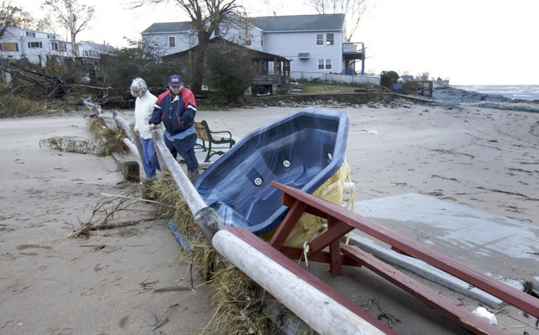 October 30, 2012: Local residents survey the damage in West Haven, Connecticut after Hurricane Sandy hit the area. (Michelle McLoughlin/Reuters)
