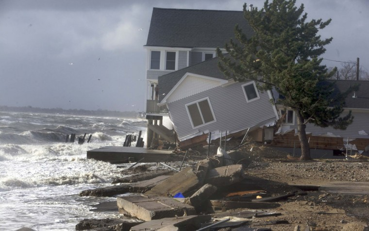 October 30, 2012: A home sits along the shoreline badly damaged by Hurricane Sandy in Milford, Connecticut. (Michelle McLoughlin/Reuters)
