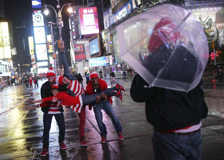 French tourists pose for a photo in the mostly deserted Times Square ahead of Hurricane Sandy in New York October 29, 2012. Hurricane Sandy is shaping up to be one of the biggest storms ever to hit the United States but even with the severe damage that is expected, the blow to the economy is seen as short-term. (Carlo Allegri/Reuters)