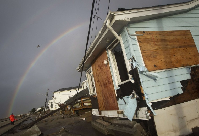 October 30, 2012: A rainbow is seen among homes devastated by the effects of Hurricane Sandy at the Breezy Point section of the Queens borough of New York. (Shannon Stapleton/Reuters)
