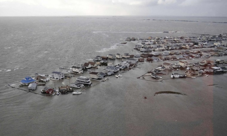 October 30, 2012: Homes are flooded after Hurricane Sandy made landfall on the southern New Jersey coastline in this U.S. Coast Guard handout photo in Tuckerton, New Jersey. U.S.Coast Guard/Handout/Reuters)