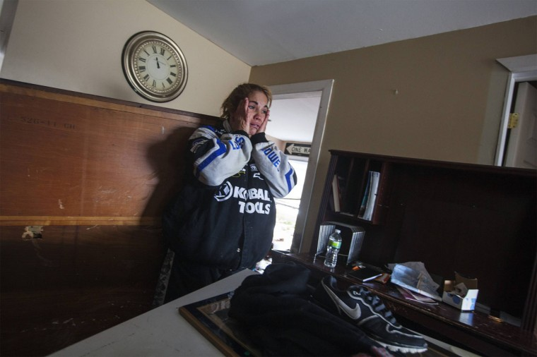 Renter Donna McBride reacts to seeing the damage done to her home by the storm surge of Hurricane Sandy in Lindenhurst, New York, October 31, 2012. (Lucas Jackson/Reuters)