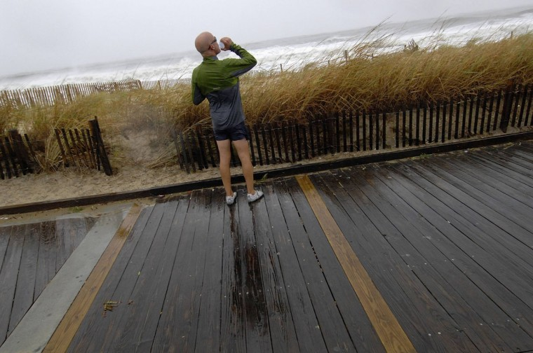 October 29, 2012: Tim McCollum takes a break from his 6-mile jog to look out at waves kicked-up by Hurricane Sandy on the boardwalk in Rehoboth Beach, Delaware. (Jonathan Ernst/Reuters)