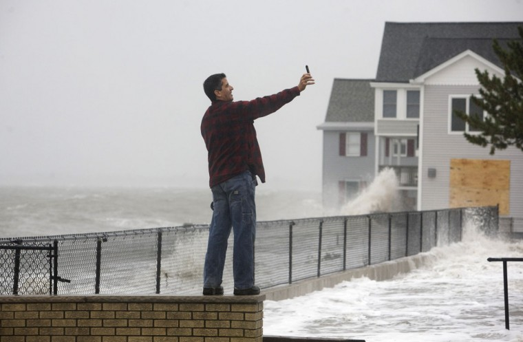 October 29, 2012: Dan Ramos takes a self portrait with his camera as Hurricane Sandy approaches Milford, Connecticut. (Michelle McLoughlin/Reuters)