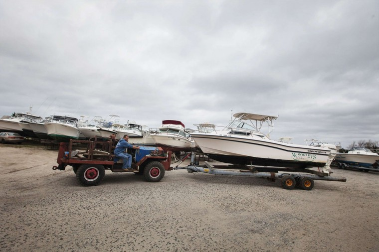 Workers remove a boat from the water for safekeeping at Ponquogue Marine Basin in preparation for the arrival of Hurricane Sandy in Hampton Bays, New York, October 28, 2012. Tens of millions of East Coast residents scrambled on Sunday to prepare for Hurricane Sandy, which could make landfall as the largest storm to hit the United States, bringing battering winds, flooding and even heavy snow. (Lucas Jackson/Reuters photo)