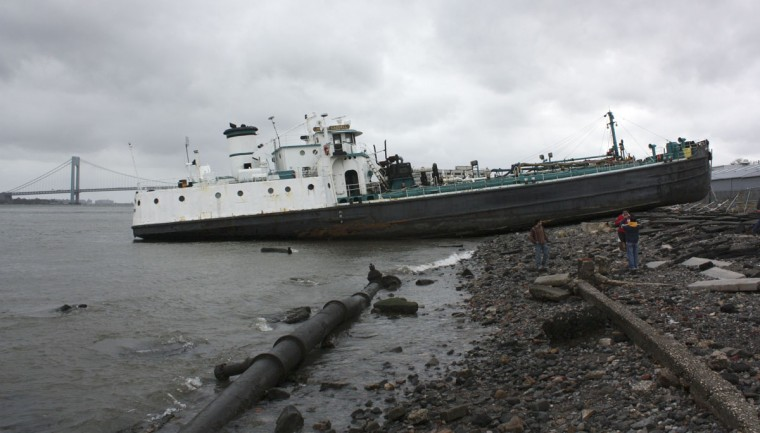 October 30th, 2012: Bystanders survey the 700-ton John B. Caddell tanker on the north shore of Staten Island, New York. The tanker ran aground Monday night from the storm surge caused by Hurricane Sandy. (Michael Berrigan/Reuters)
