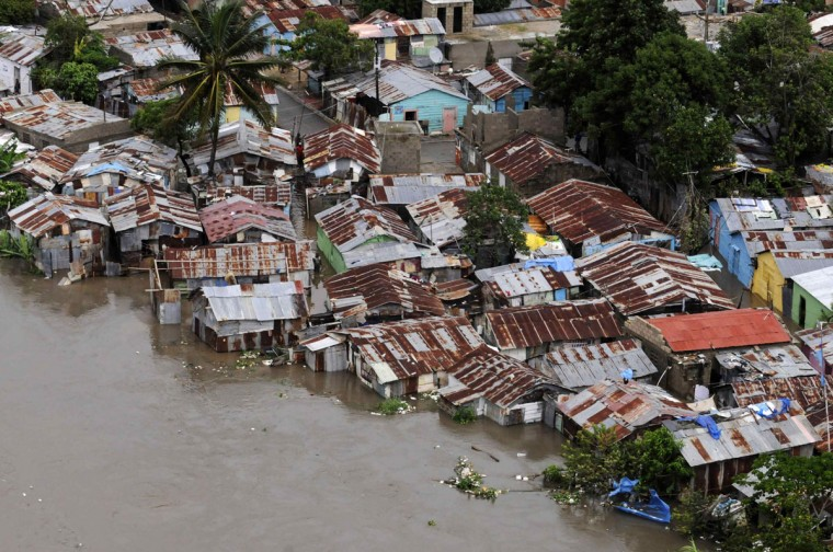 October 26, 2012: The neighbourhood of Barquita is seen submerged in flood waters after days of heavy rain in Santo Domingo. (Ricardo Rojas/Reuters)