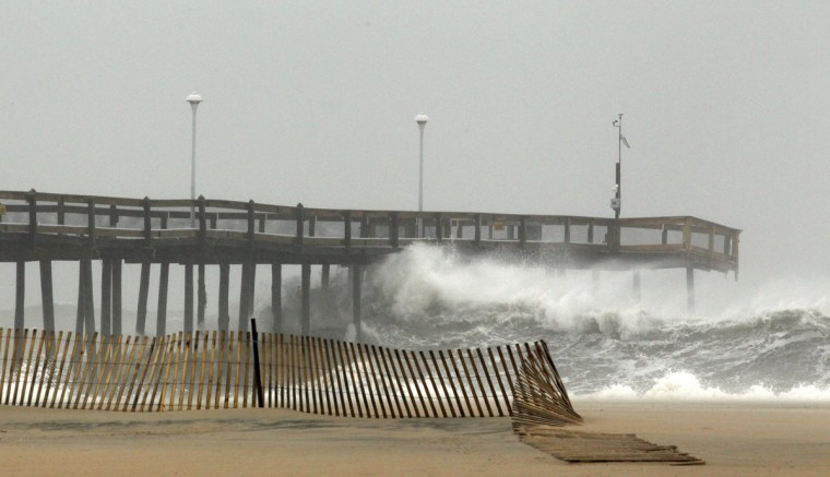Waves crash into the pier in Ocean City, Maryland October 28, 2012. Tens of millions of East Coast residents scrambled on Sunday to prepare for Hurricane Sandy, which could make landfall as the largest storm to hit the United States, bringing battering winds, flooding and even heavy snow. (Kevin Lamarque/Reuters photo)