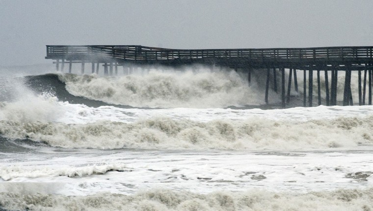 October 29, 2012: Waves crash on shore from high surf ahead of Hurricane Sandy at the pier at Virginia Beach, Virginia. (Rich-Joseph Facun/Reuters)