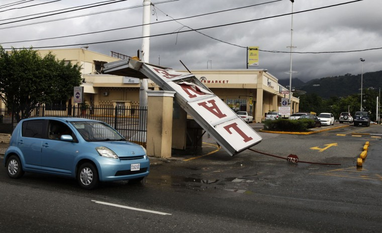 October 25, 2012: A supermarket sign lies at the entrance after it was blown down by Hurricane Sandy in Kingston. (Gilbert Bellamy/Reuters)