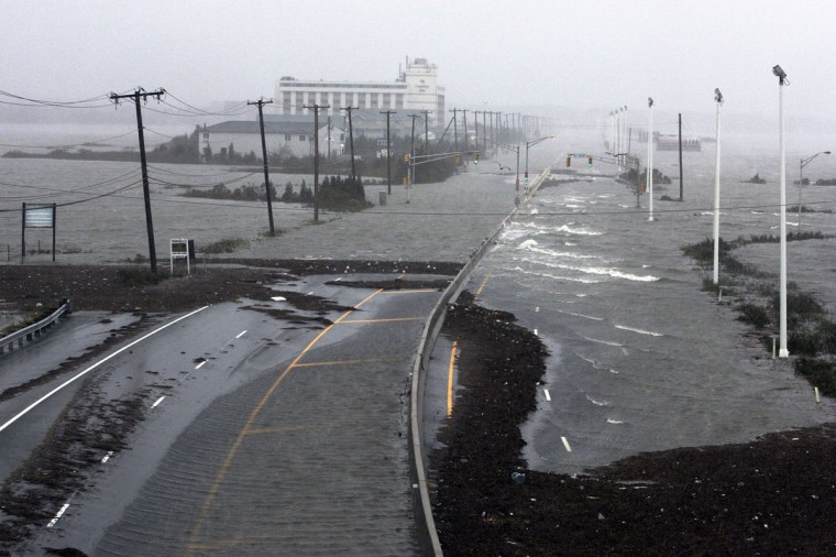 October 29, 2012: U.S. Route 30, the White Horse Pike, one of three major approaches to Atlantic City, New Jersey, is covered with water from Absecon Bay in this view looking west, during the approach of Hurricane Sandy. (Tom Mihalek/Reuters)