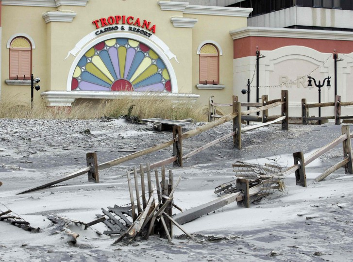 October 30, 2012: A pathway to the beach from the boardwalk is buried in sand up to the railings, at a beach in the aftermath of Hurricane Sandy in Atlantic City, New Jersey. (Tom Mihalek/Reuters)