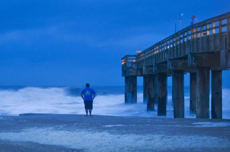 Stanley Sicinski looks at storm surf before sunrise in St. Augustine Beach, Florida, as Tropical Storm Sandy, downgraded overnight, passes offshore on Oct. 27, 2012. (Steve Nesius/Reuters)
