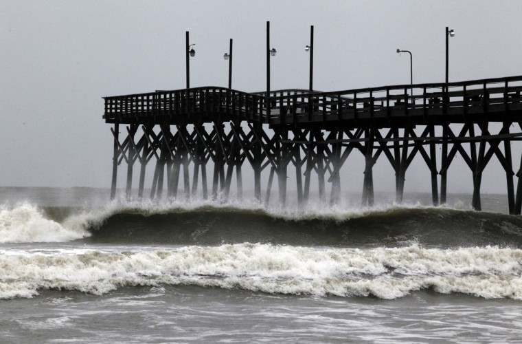 Big waves break near the Sunset Beach pier as Hurricane Sandy passes the coast of North Carolina on October 27, 2012. The hurricane closed in on the United States on Saturday, where it threatens to hit the eastern third of the country with torrential rains, high winds, major flooding and power outages. (Randall Hill/Reuters)