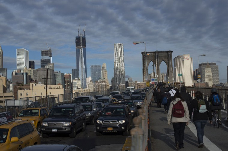 Commuters make their way across the Brooklyn Bridge after subway service was suspended due to flooding from Hurricane Sandy. With New York City's subway system paralyzed, millions of commuters are rethinking how they will get to work this week, and they are taking it one step at a time. (Keith Bedford/Reuters)
