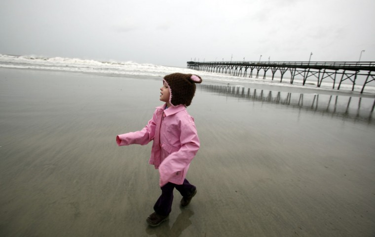 Brooke Halye, 3, plays in the surf with her family as Hurricane Sandy looms over the coast in Sunset Beach, North Carolina. The hurricane closed in on the United States on Saturday. (Randall Hill/Reuters)