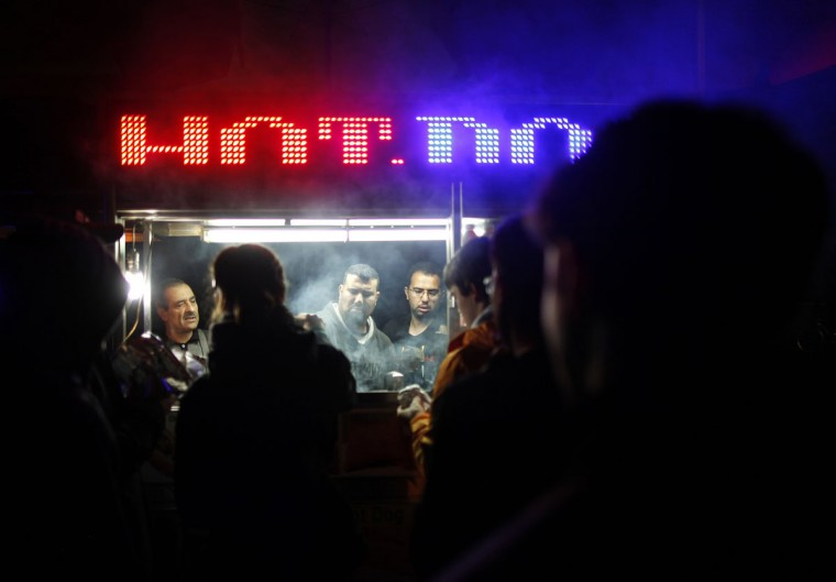 People line up to buy food from a cart in the aftermath of Hurricane Sandy in New York October 30, 2012. Millions of people were left without power in the aftermath of the storm's whipping winds and heavy rains. (Carlo Allegri/Reuters)