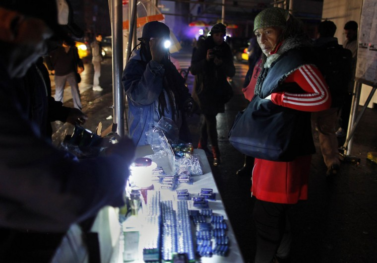 A woman asks the price of a flashlight in the aftermath of Hurricane Sandy in New York. Millions of people were left reeling after the massive storm's whipping winds and heavy rains, as New York City and many parts of the eastern U.S. struggled with epic flooding and extensive power outages. (Carlo Allegri/Reuters)