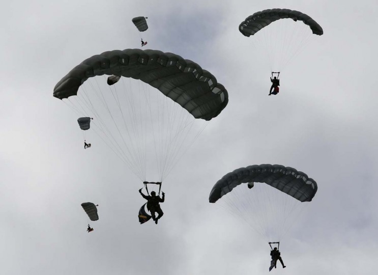 Parachutists of the Swiss Air Force perform during a flight demonstration of the Swiss Air Force over Axalp in the Bernese Oberland. (Pascal Lauener/Reuters photo)