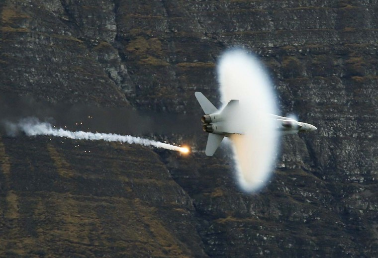 A Swiss Air Force F18 fighter jet releases flares during a flight demonstration of the Swiss Air Force over the Axalp in the Bernese Oberland. (Pascal Lauener/Reuters photo)