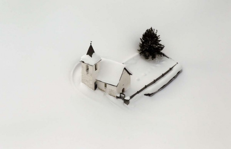 An aerial view shows the snow covered church of the village of Jenisberg near the Swiss mountain resort of Davos January 23, 2012. (Arnd Wiegmann/Reuters)