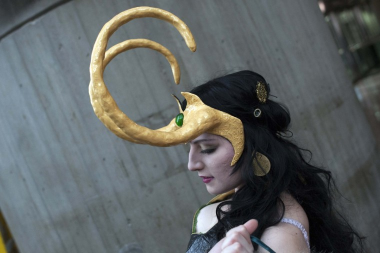 Dressed as the comic book character Loki, fan Alina Vukul, adjusts her costume during Comic Con at the Jacob Javitz Center in New York. (Keith Bedford/Reuters)