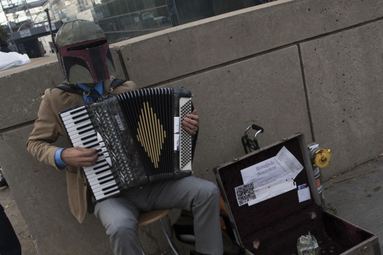 A participant dressed as Star Wars character Boba Fett plays the accordion during Comic Con at the Jacob Javitz Center in New York. (Keith Bedford/Reuters)