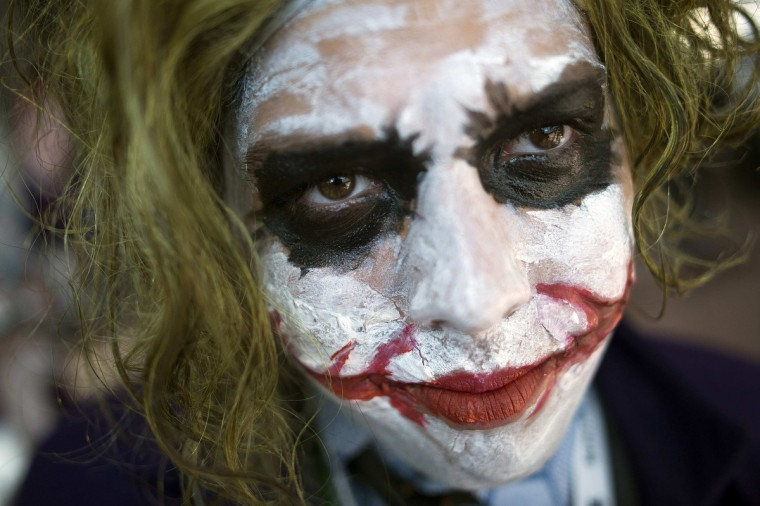 Fan Frank Radice, dressed as the comic book character The Joker, poses for a photograph during Comic Con at the Jacob Javitz Center. (Keith Bedford/Reuters)