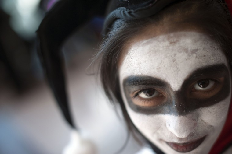 Fan Shermeen Saeed, dressed as the Batman comic book character Harley Quinn, poses for a photograph during Comic Con at the Jacob Javitz Center in New York. (Keith Bedford/Reuters)