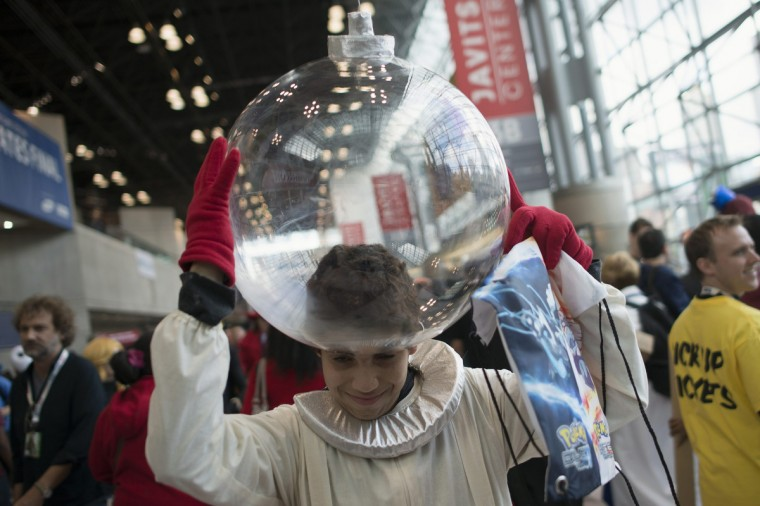 Fan Christian Borges, dressed as Captain Olimar of the Pikmin video game series, adjust his helmet to his costume during Comic Con at the Jacob Javitz Center. (Keith Bedford/Reuters)