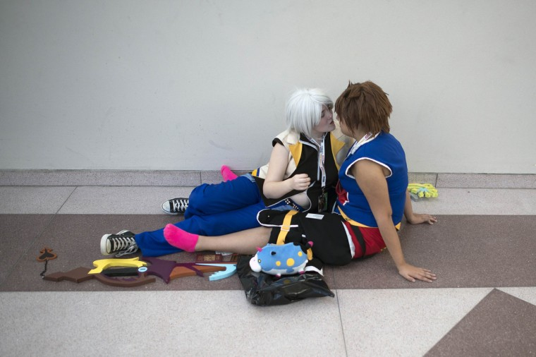 Dressed as characters from the video game Kingdom Hearts, fans Jackie Andrews and Fernanda Bernades (R), share a kiss as they relax during Comic Con at the Jacob Javitz Center in New York. (Keith Bedford/Reuters)