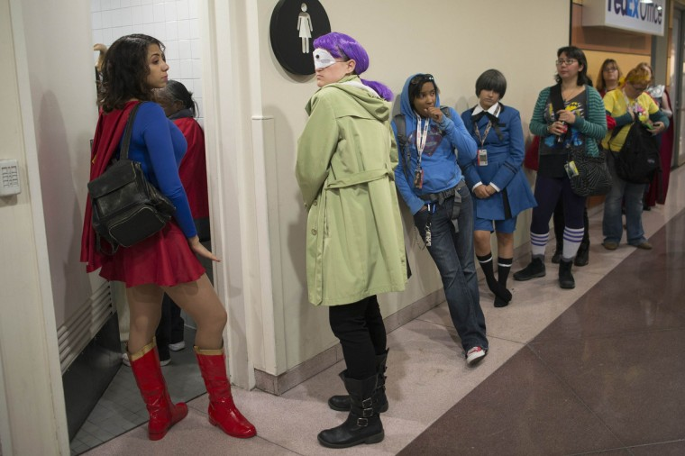Costumed participants wait in line to use the restroom during Comic Con at the Jacob Javitz Center in New York. (Keith Bedford/Reuters)