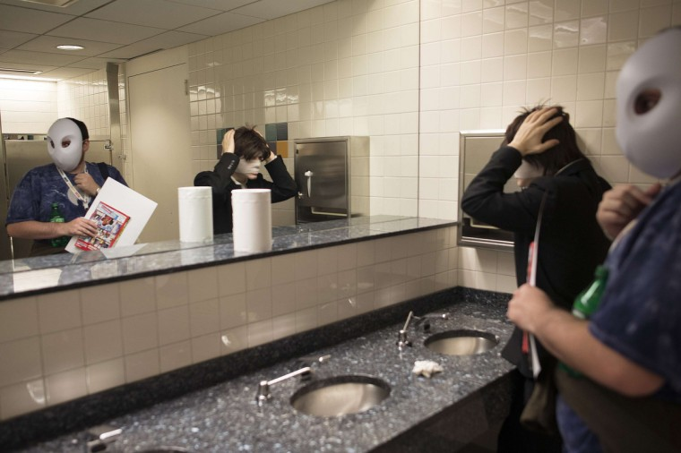 Participants adjust their costumes using the restroom mirror during Comic Con at the Jacob Javitz Center in New York. (Keith Bedford/Reuters)