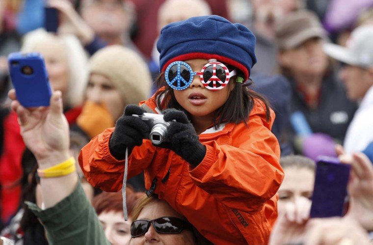 A young girl tries to get a photo of U.S. President Barack Obama during a campaign rally in Denver, Colorado. (Kevin Lamarque/Reuters photo)